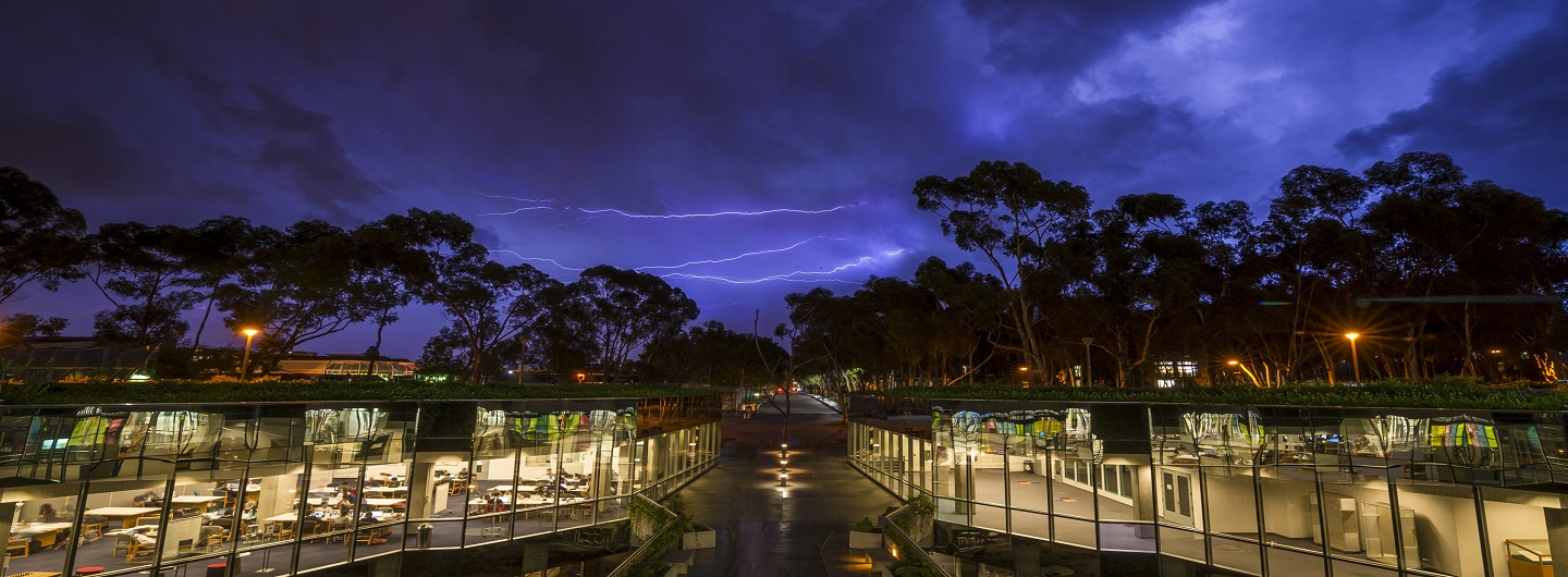 Giesel library at night with lightning striking